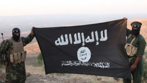 Oct 17, 2013 - Aleppo, Syria - ISIS fighters holding the Al-Qaeda flag with 'Islamic State of Iraq and the Levant' written on it. on the frontline. Islamic State of Iraq and the Levant aka ISIS. The group An-Nusra Front announced its creation January 2012 during the Syrian Civil War. Since then it has been the most aggressive and most effective rebel force in Syria. The group has been designated as a terrorist organization by the United Nations. April 2013, the leader of the ISIS released an audio statement announcing that Jabhat al-Nusra is its branch in Syria. (Credit Image: © Medyan Dairieh/ZUMA Wire/ZUMAPRESS.com)